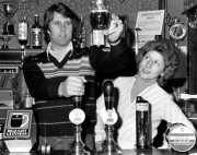 Geoff Hurst pulling a pint with his wife Judith