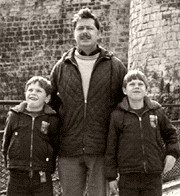 Eddie Izzard (left) with his father and brother