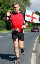 Eddie Izzard on the road during one of his marathons in England