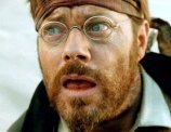 Eddie Izzard as Prosit Luckner in 'Blueberry' (2004)