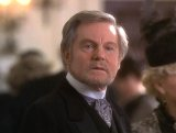 Derek Jacobi as Father Frederick in 'Basil' (1998)
