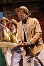 Danny John-Jules as Mac in Playboy of the West Indies