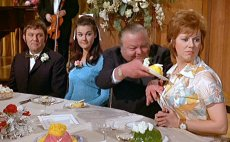 Anna Karen about to get food tipped down her front in 'Carry On Loving'!
