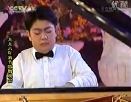 Lang Lang performing in 1996, aged fourteen
