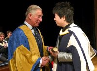 Lang Lang receives his Hon DMus degree from Prince Charles at the Royal College of Music in May 2011