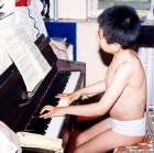 Young Lang Lang practising the piano