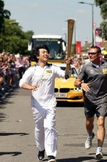 Lang Lang carrying the 2012 Olympic torch through Hornchurch