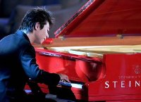 Lang Lang performs in New York with his red Steinway piano