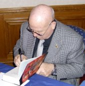 Alexei Leonov signing his book 'Two Sides of the Moon'