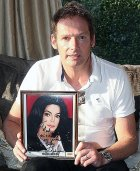 Mark Lester with his signed photograph from Michael Jackson