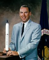 Jim Lovell with model of a Titan rocket 1964