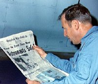 Jim Lovell reading about the safe return of Apollo 13