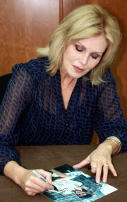 Joanna Lumley signing Ciaran Brown's 'Purdey' photograph at Autographica