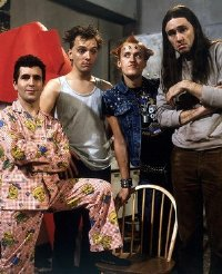 Christopher Ryan, Rik Mayall, Adrian Edmondson & Nigel Planer in 'The Young Ones'