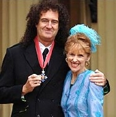 Brian May CBE, with his wife Anita Dobson at Buckingham Palace in 2005