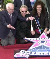Johnny Grant (Mayor of Hollywood), Roger Taylor & Brian May at the unveiling of the Queen 'Walk of Fame' star on Hollywood Boulevard