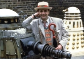 Sylvester McCoy relaxes with his Dalek enemies in the 1988 25th anniversary story, 'Remembrance of the Daleks'