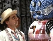 Sylvester McCoy as The Doctor confronts The Kandy Man in 'Doctor Who - The Happiness Patrol'