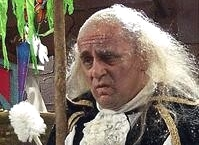 Sylvester McCoy as The Lord Chamberlain in 'See It Saw It'