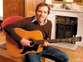 Ben Miller relaxes at home with his guitar
