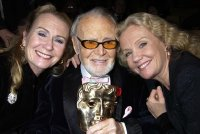 Juliet & Hayley Mills and their father Sir John Mills with his BAFTA Fellowship Award in 2002