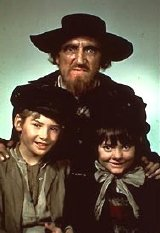 Ron Moody with Mark Lester & Jack Wild from 'Oliver!'