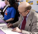 Ron Moody drawing a Fagin cartoon for Ciaran Brown