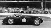 Stirling Moss racing a C-type Jaguar in 1953