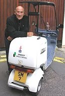 Sir Stirling Moss with his scooter and SM7 number plate