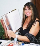 Caroline Munro with Ciaran Brown's Bond Girls book