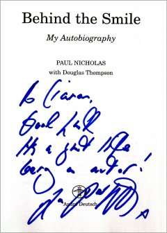 Title page of 'Behind the Smile' signed by Paul Nicholas
