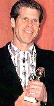 Ron Perlman with his Golden Globe award in 1989