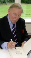 Leslie Phillips signing his autobiography at Pinewood