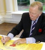 Leslie Phillips signing 'Carry On' poster at Pinewood