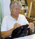 Dave Prowse signing a Darth Vader bag