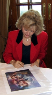 Blanche Ravalec signing the Moonraker lithograph