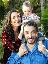 John Rhys-Davies with partner Lisa Manning and their young daughter.