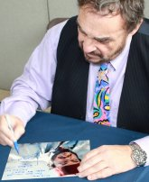 John Rhys-Davies signing a photo of him as Sallah from 'Raiders of the Lost Ark'