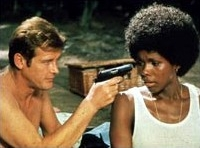 Roger Moore & Gloria Hendry in 'Live And Let Die'