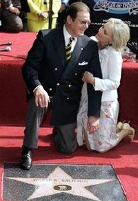 Sir Roger Moore and his wife Kiki  with his plaque on the 'Hollywood Walk Of Fame'