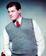 Roger Moore models knitwear in the 1950s
