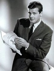 Roger Moore with a script from The Saint