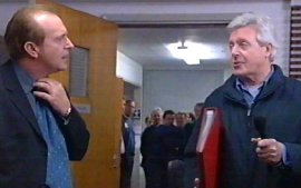 Simon Rouse is surprised by 'This Is Your Life' host Michael Aspel on the set of 'The Bill'