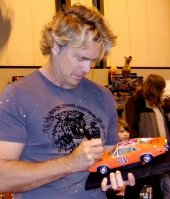 John Schneider signing model of the 'General Lee'