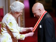 Sir Patrick Stewart receiving his knighthood from the Queen