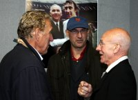 Patrick Stewart and his son Daniel discuss football with Martin Chivers at the MK Dons stadium