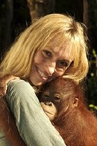 Michaela Strachan with an orang-utan on 'Orang-utan Rescue'