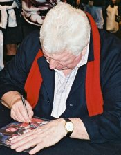 Tom Baker signing photograph