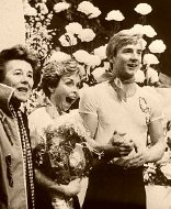 Torvill and Dean with coach Betty Calloway watch the scores for their 'Bolero' routine  in 1984