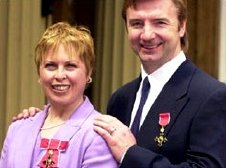 Torvill and Dean with their OBEs at Buckingham Palace